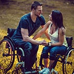 Couple both in wheelchairs in love.